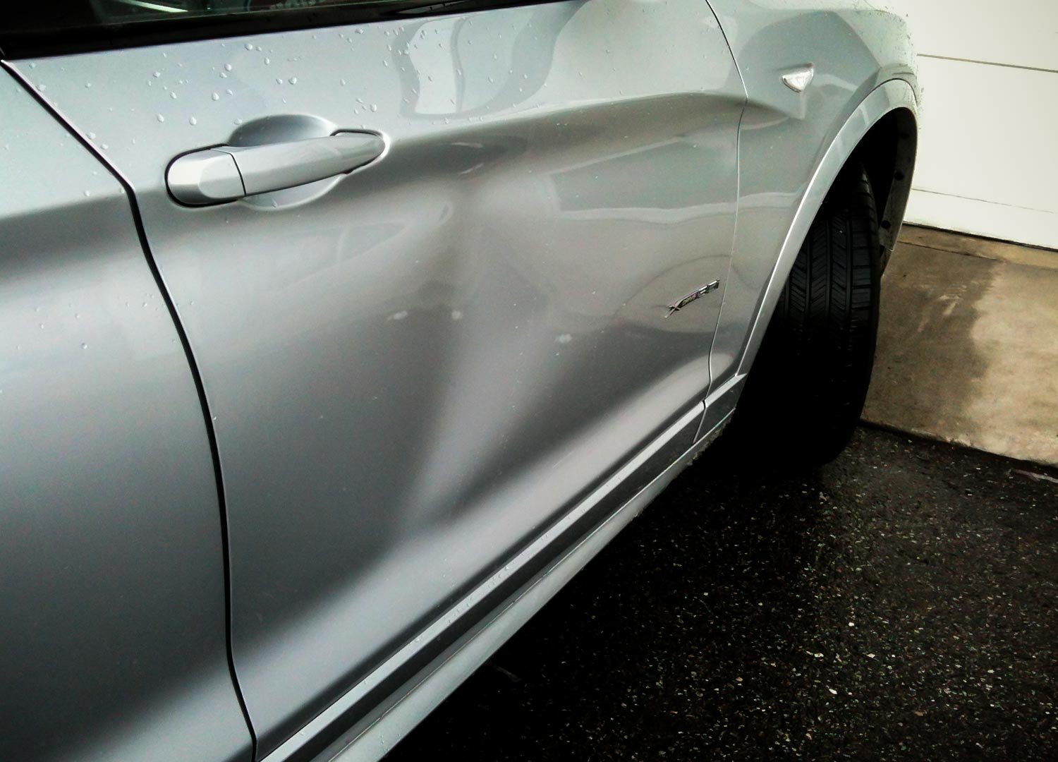 Year2013; MakeBMW; ModelX3; Dent LocationDoor Panel; ShopKelowna & 2013 BMW X3 dent in door panel - Dentique Paintless Dent Repair